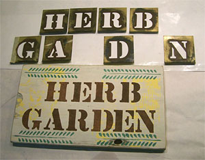 Finished wood garden sign with stencils.