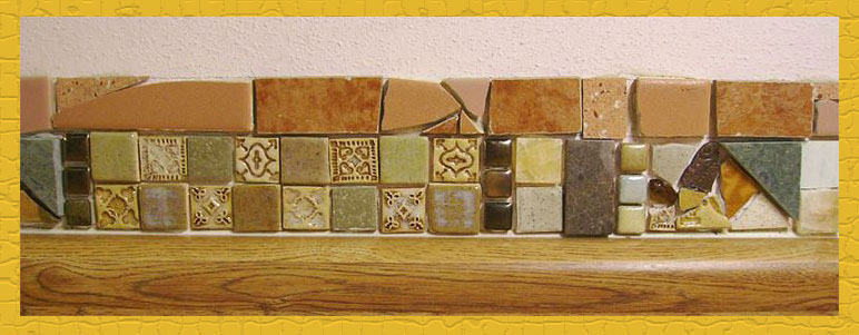 Close up of tile design that includes handmade tiles, purchased tiles, and salvaged tiles.
