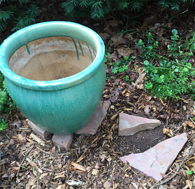 Raising containers off the ground with decorative sandstone pieces