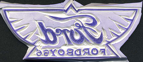 Design elements of the stamp have been outlined with an X-acto knife.