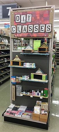 Pollinator houses on display on endcap