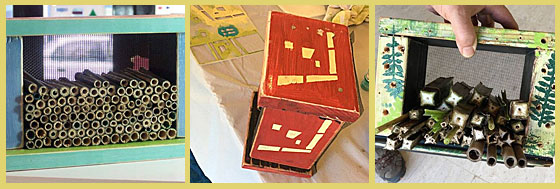 Three wood pollinator houses with stenciled decoration