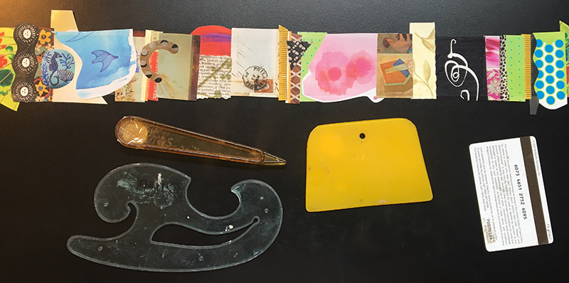 Here are some tools you can use to burnish the images firmly onto the tape - bone folder, squeegee, French curve, old gift card.