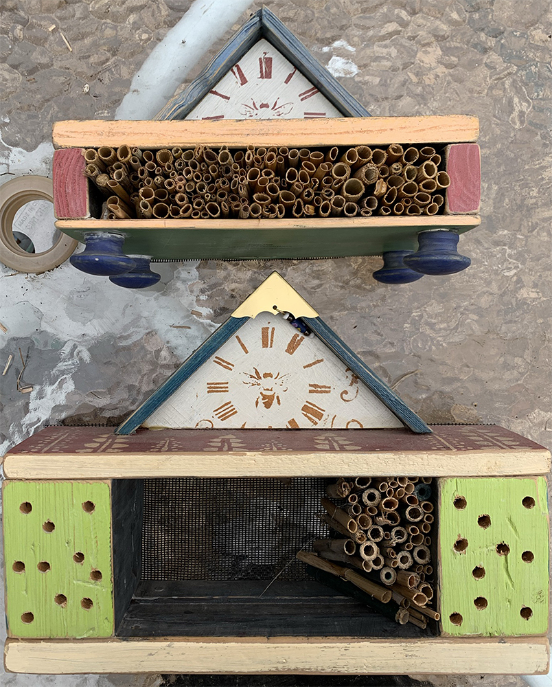 Pollinator houses with straw